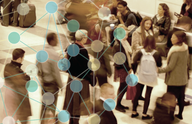 crowd of people in an airport terminal with a dot and line overlay